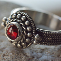 early medieval red eye ring