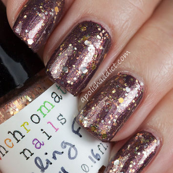 Stealing From Charity Nail Polish - color-shifting glitter topcoat
