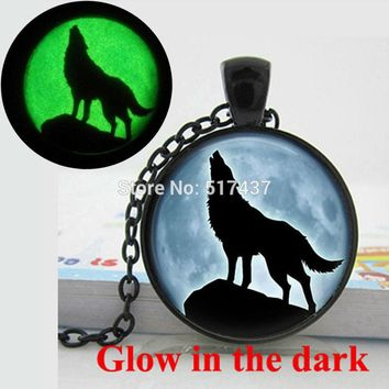 Glow in the Dark Wolf Howling at the Moon glass dome Necklace