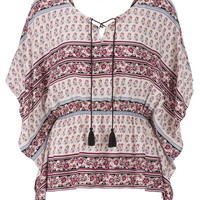 poncho top in floral pattern