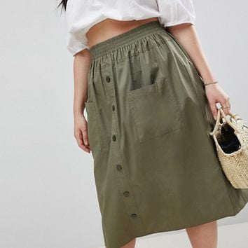 ASOS DESIGN Curve cotton midi skirt with button front at asos.com