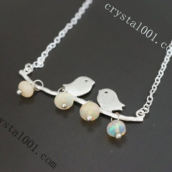 Sterling silver delicate bird fire opal necklace