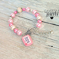 hope for a cure breast cancer awareness bracelet in hot pink and light pink