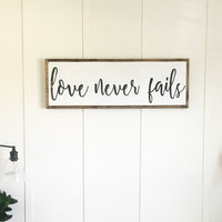 """Love Never Fails"" Oversized Sign"