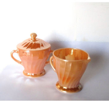 MId century Anchor hocking fire king peach luaterware sugar and creamer set. Swirl pattern. Made in USA.