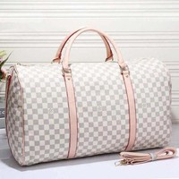 GKUN7 Louis Vuitton Leather Travel Bag