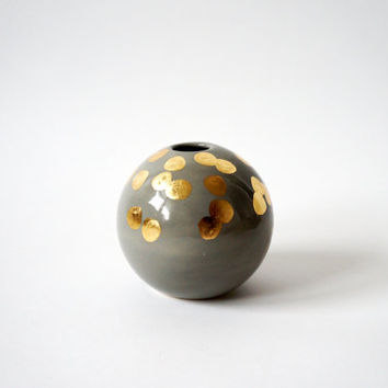 gray and gold spherical bud vase
