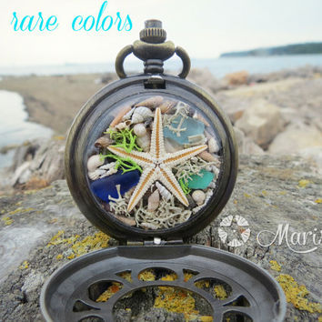 Antique bronze locket with REAL seastar, Real & RARE seashells, Real moss, Real corals and sea glass in RARE colors.Terrarium mermaid locket