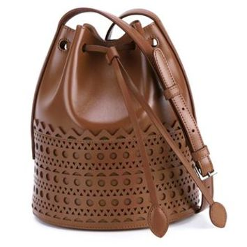 AZZEDINE ALAÏA | Laser Cut Leather Bucket Bag | Womenswear | Browns Fashion