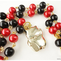 Nyanko Sensei Black and Red Maneki Neko necklace in gold