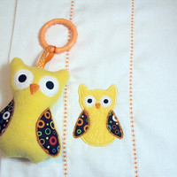 Bright yellow owl burp cloth with matching owl toy with c clip for boys or girls. Burp cloth can be personalized for an extra charge.