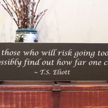 Wood sign - Only those who will risk going too far can possibly find out how far one can go