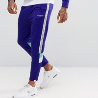 Illusive London Skinny Track Joggers In Purple With Taping at asos.com