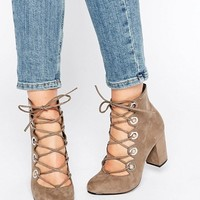 Office Mission Eyelet Tie Up Mid Heeled Shoes at asos.com