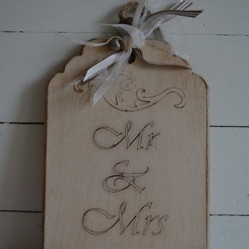 Wooden sign/tag with a vintage, rustic aged look with the text MR & MRS --- Lovely as wedding decor or wedding keepsake