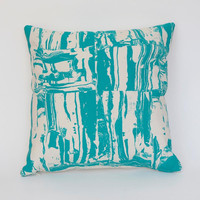 Screen-printed Clay Shapes pillow in turquoise