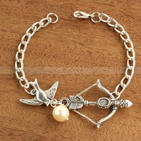 Charm bracelet-Mockingjay bracelet with Katniss Bow and Peeta Pearl inspired by The Hunger Games