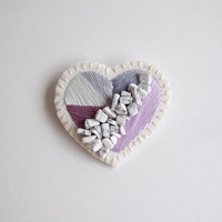 Valentine's Day heart brooch hand embroidered with geometric shapes of lavender and grays with white howlite gem beads on cream muslin