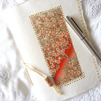 Abstract red and gold design covers this Sketch Book, Journal or Notebook with blank pages