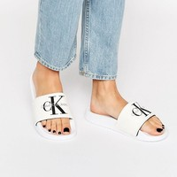 Calvin Klein Jeans Chantal White Slider Flat Sandals at asos.com