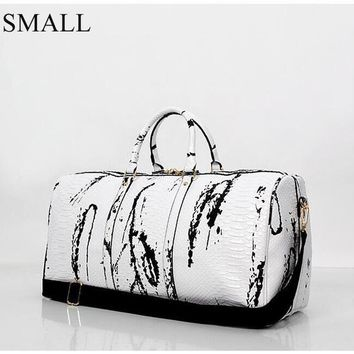 Trendy Black and White Leather Duffle Bag