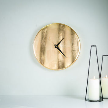 Wall clock Golden wave. Hand gilded bu yellow metal leaves.
