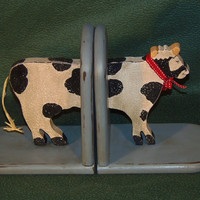 Vintage handmade wooden cow book ends