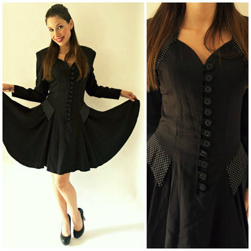 Fabulous vintage 1980's long sleeved party dress in black with sweet heart neckline, button up front and polka dot detailing, size 6/8