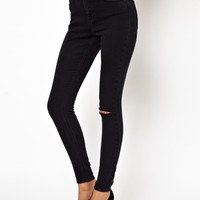 ASOS Ridley High Waist Ultra Skinny Jeans in Washed Black with Ripped Knee at asos.com