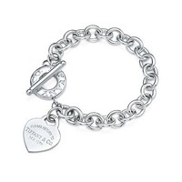 Tiffany & Co. -  Return to Tiffany™ medium heart tag in silver on a toggle bracelet, medium.