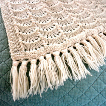 Beautiful cream knitted blanket in a scalloped wave pattern. A pretty off white to match any decor