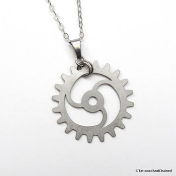 Steampunk gear pendant, 3 spoke spiraled gear