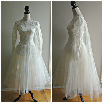 Stunning 1950's ivory lace, satin and tulle tea length wedding dress with long sheer lace sleeves and built in train. size small or US 4/6.