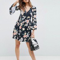 ASOS Smock Dress With V Neck and Trumpet Sleeve In Floral Print at asos.com