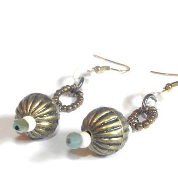 Earthy dangle earrings with beaded circles and green crystals