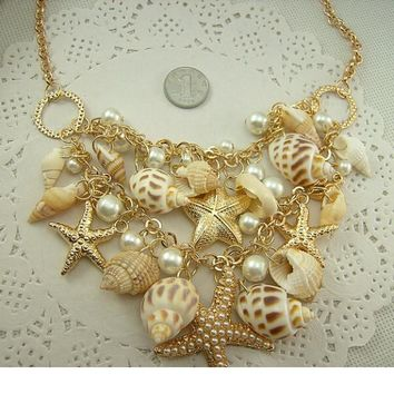 Necklace. Conch Shell Starfish Simulated pearl Fashion Sea Star Plated Multitiered Necklace & Pendant