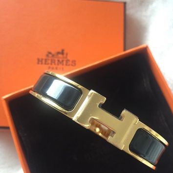 Hermes black and gold clic clac bracelet NEW with Harrods receipt
