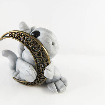 Polymer clay silver baby dragon with a moon