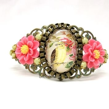 Bird cameo bracelet, meadowlark bird cameo embellished with rhinestones, resin flowers on antiqued bronze cuff bracelet. Filigree cuff