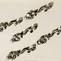 Pretty Silver Swirl & Curved Bindi with Crystal with Black Background.
