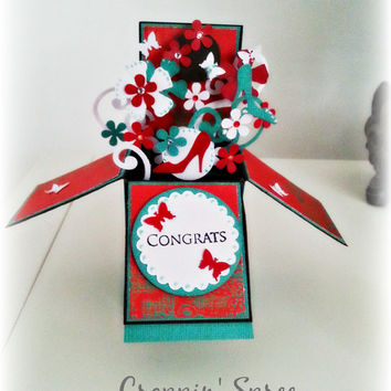 3d box card. Explosion card. Teal, white and red.Pop up card in a box.Ready to ship. Ornate card with heels,flowers and butterflies.Keepsake