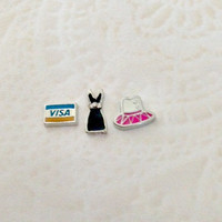 Floating charms  Visa card ... Little black dress ... pink and white dress