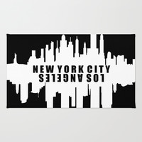 New York City / Los Angeles City Skyline Area & Throw Rug by KJ53321 | Society6