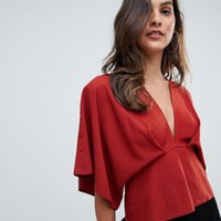 ASOS DESIGN plunge top with batwing at asos.com