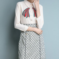 The latest fashion slim body embroidery hem print patchwork art long dress