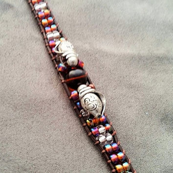 Shell themed bracelet. Wrapped on leather with Antique Button clasp.