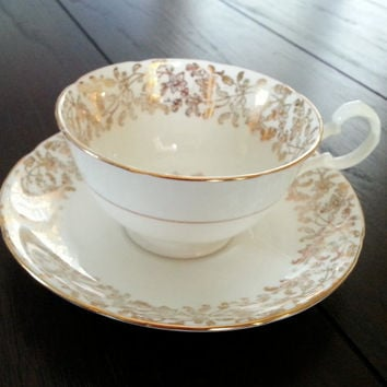 Antique Royal Grafton gold and white floral tea cup and saucer tea set