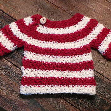 Christmas Holiday baby sweater in red & cream with expandable neck opening, wooden button; made with super soft fluff yarn