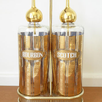 Vintage Culver scotch and bourbon decanters with pouring spouts and a wood handled stand