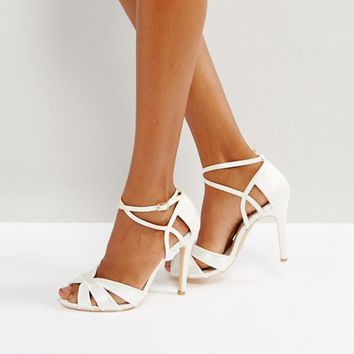 True Decadence Ivory Strappy Bow Heeled Sandals at asos.com